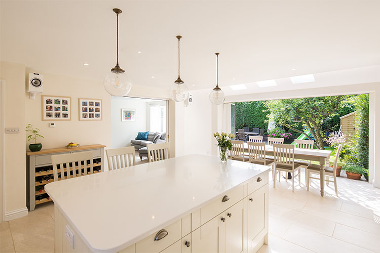 View to garden from open plan kitchen diner in a 1920s semi-detached house with modern extension and loft conversion by Space Program Architects