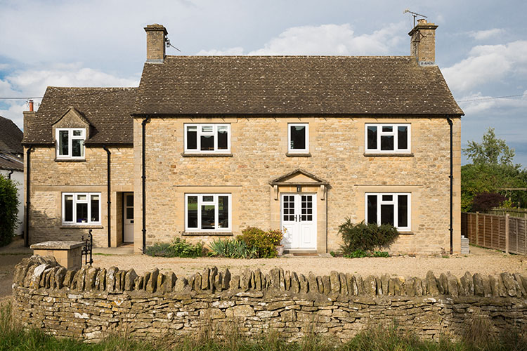 Front view of Cotswold House with extension by Space Program Architects