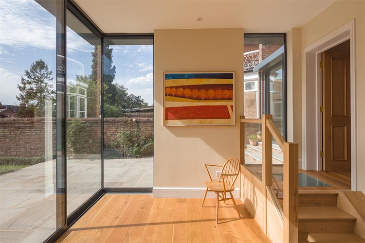 View towards garden from garden living room in modern house extension by Space Program Architects