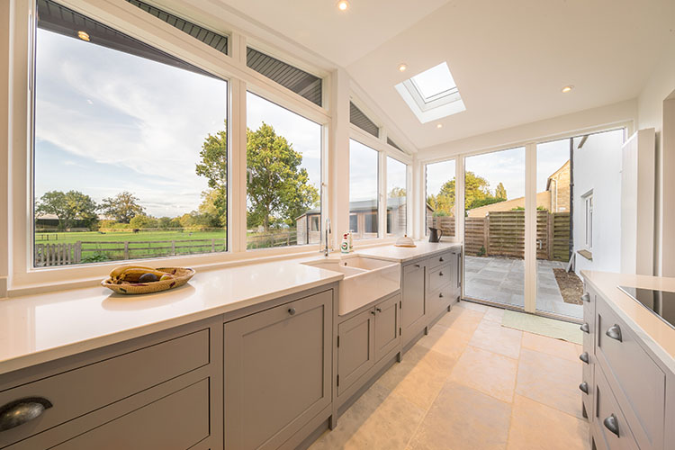 View of open plan kitchen in Cotswold House with modern extension by Space Program Architects