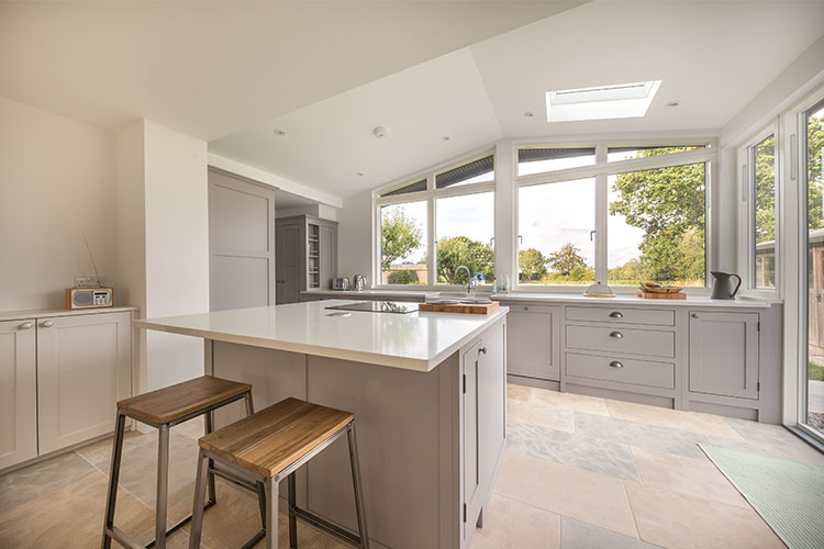 View of open plan kitchen diner in Cotswold House with modern extension by Space Program Architects
