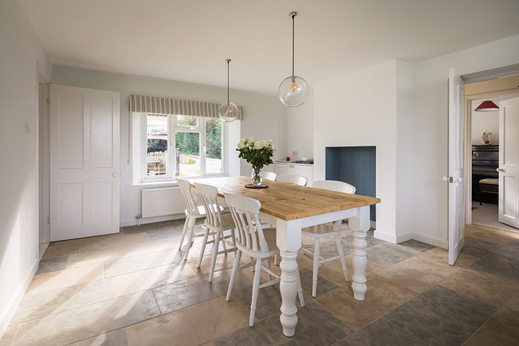View of open plan dining space in Cotswold House with modern extension by Space Program Architects
