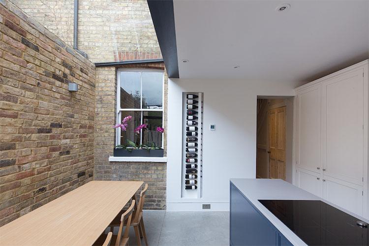 Open plan kitchen dinner in modern Victorian terrace side return by Space Program Architects