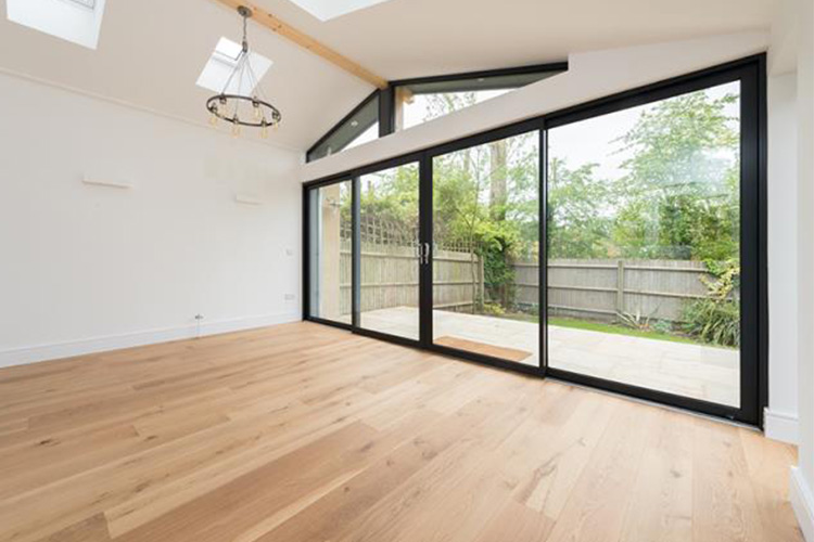 Full width bi-fold doors from living room extension to garden by Space Program Architects
